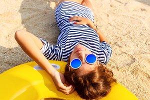 Beautiful girl rest on sandy beach.