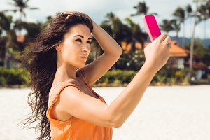 Beautiful fit girl with smartphone.