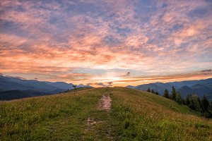 Footpath in the mountains at sunset