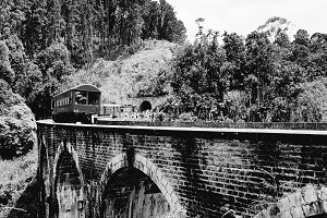 Old train on bridge - b&w