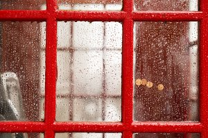 Big ben and red phone cabine. Rainy
