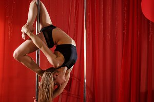 Pole dancer performs at pylon.
