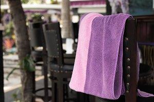 Towel beach on the bar chair. Tropical island Bali, Indonesia.