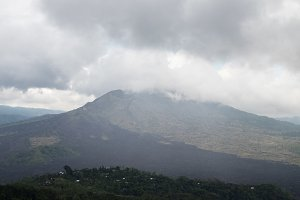 Cloudy weather in mountains, cloudy and fog. Tropical Bali island, Batur volcano, Indonesia.