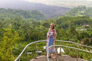 Senior woman on the mountain landscape of tropical Bali island, Indonesia.