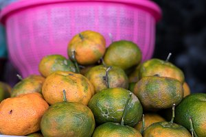 Fresh mandarin oranges on local food organic market, Bali island, Indonesia.