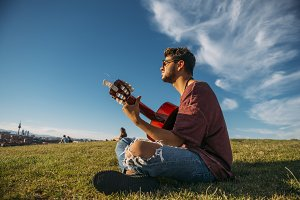 Boy with guitar in a park, from Madr