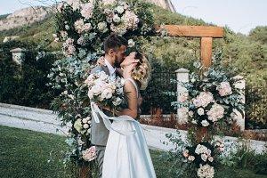 Wedding couple kiss on ceremony
