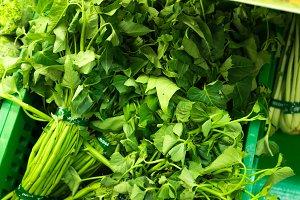 Lettuce Lactuca in the market, different grades, summer closeup, macro photography. Farmer market on Bali, organic food.