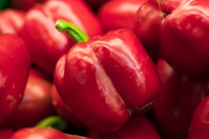 Fresh red organic sweet bell peppers on the farmer market on a tropical island Bali, Indonesia. Organic background.