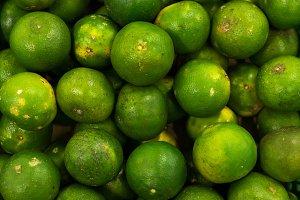 Bunch of fresh green mandarin in the organic food market. Tropical Bali island, Indonesia.