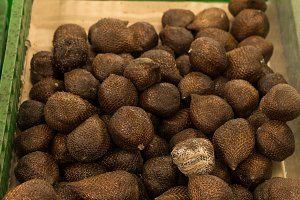 Close up of salak fruit Salacca zalacca on a local organic market for sale. Selected focus. Tropical Bali island, Indonesia.