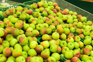 Background of apples on sale at the local organic market of tropical Bali island, Indonesia.