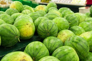 Many big sweet green watermelons sell on market. Local organic market on tropical Bali, Indonesia. Watermelon background.