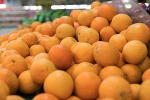Fresh oranges on a local organic farm market on a tropical Bali island, Indonesia. Oranges background.