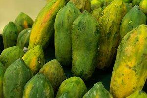 Green fresh Papaya in the local organic market of tropical Bali island, Indonesia. Asia. Papaya background.