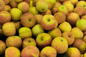 Fresh apples background. Apples on a local organic farm market of Bali island, Indonesia.