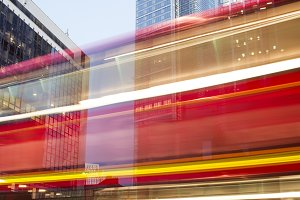 Red Bus in motion in City of London