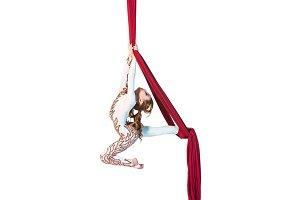 Graceful gymnast performing aerial exercise