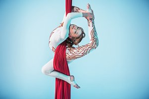 Graceful gymnast performing aerial exercise