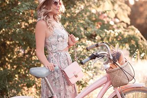 Stylish girl with bike