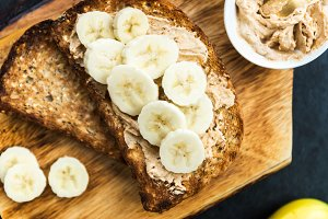 Toasts from Wholewheat Seeded Bread with Peanut Butter and Banan