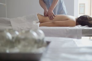 Girl at a massage in the spa salon