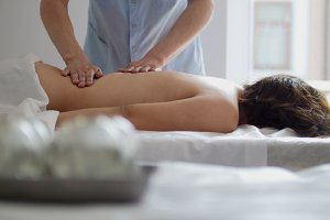 Spa. The girl is given a massage in the lower back