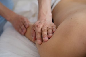 Masseur doing massage on hand