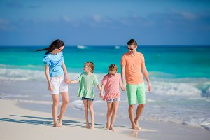 Family of four on a tropical beach