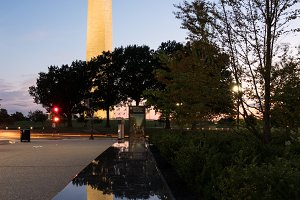 Reflection of Washington Monument in bench