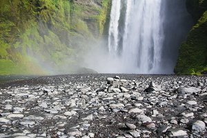 Skogafoss is a waterfall located in the south of Iceland at the cliffs of the former coastline.