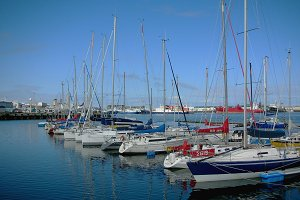 Boats in the water at the harbor of Reykjavik in Iceland