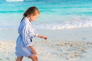 Little girl on white beach