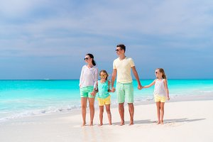 Happy family on a tropical beach
