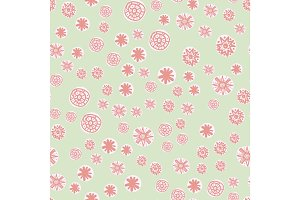 Cute seamless pattern with colorful stylized stars or snowflakes. Childish texture for fabric, textile, wrapping paper. Vector Illustration
