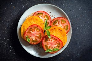 Colorful tomatoes with basil