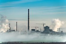 Factory chimneys and clouds of steam