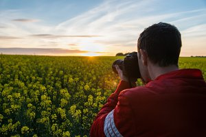 Photographer with camera in nature