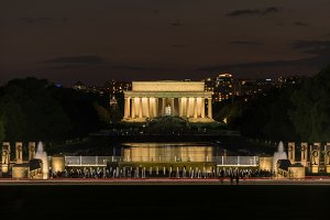 Lincoln Memorial at night over World War Two memorial
