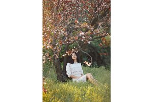 Woman in park. Pleasure of spring nature.