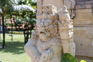 Traditional balinese statue in the public park. Bali island, Indonesia.