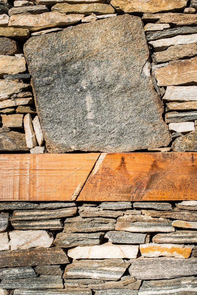Wall built of stones. Sun light - Architecture