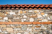 Wall built of stones. Sun light