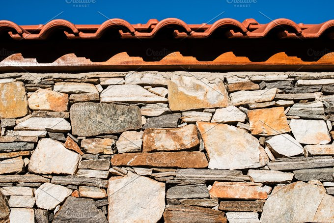 Wall built of stones. Sun light - Architecture