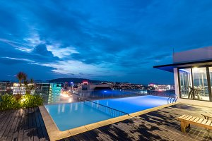 A resort swimming pool on the roof at night. Kota Kinabalu city, Malaysia.