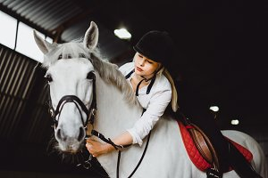 Beautiful blonde riding a horse