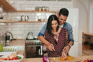 Romantic couple cooking in kitchen