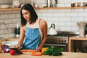 Beautiful woman watching recipe