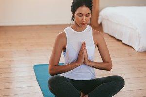 Fitness woman meditating in yoga